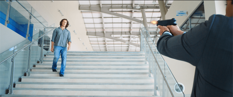 Ben being shot at a stair - Mind Talker Movie